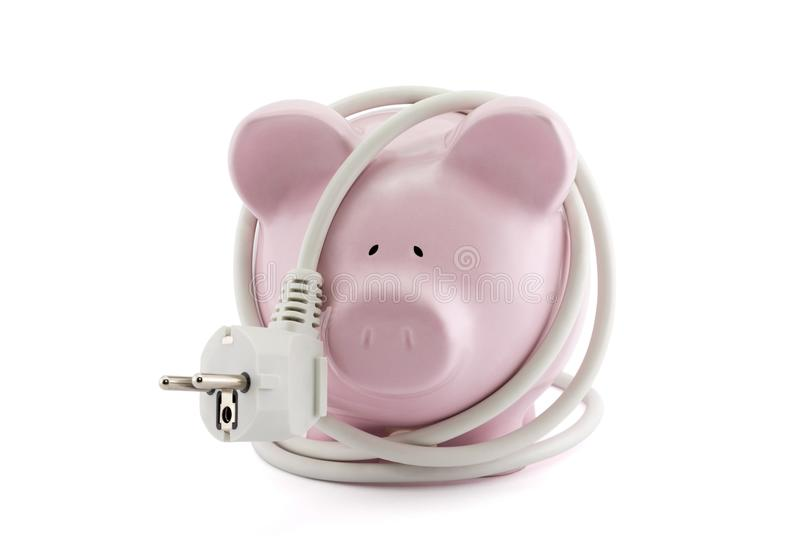 Energy Savings concept. Piggy bank with power plug. Clipping path included stock photography