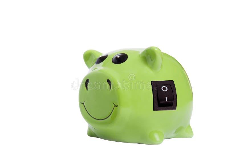 Energy savings concept. Piggy bank with power switch as energy savings concept royalty free stock photo