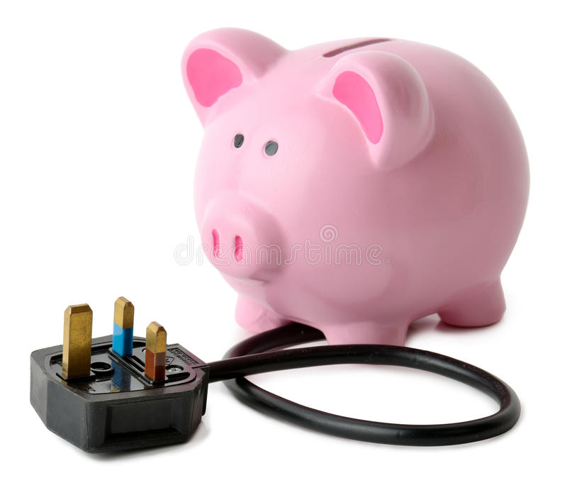 Energy savings. Concept of saving energy a piggy bank with a plug isolated on a white background royalty free stock photos