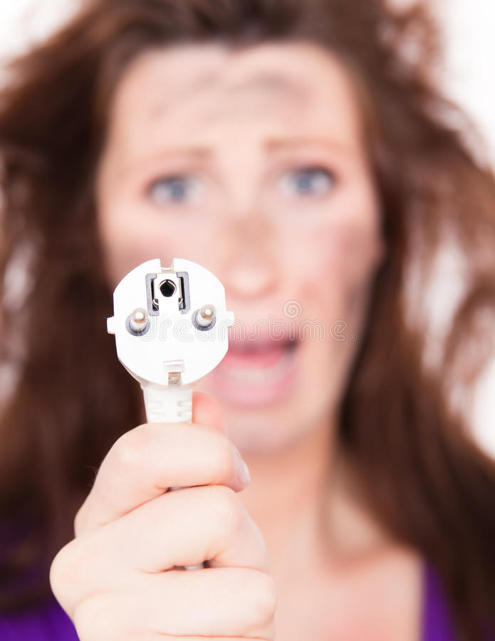 Energy shock. High voltage woman smoking cable royalty free stock photo