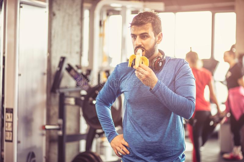 Energy supplement. Man at gym. royalty free stock photography