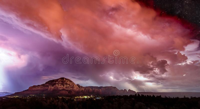 Energy Surges over the Sedona Sky. A summer monsoon in Sedona Arizona brings large lightning strikes across the sky royalty free stock photography