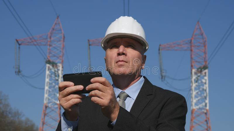Energy Working in Energetic Industry Using Mobile in Maintenance Work.  royalty free stock images