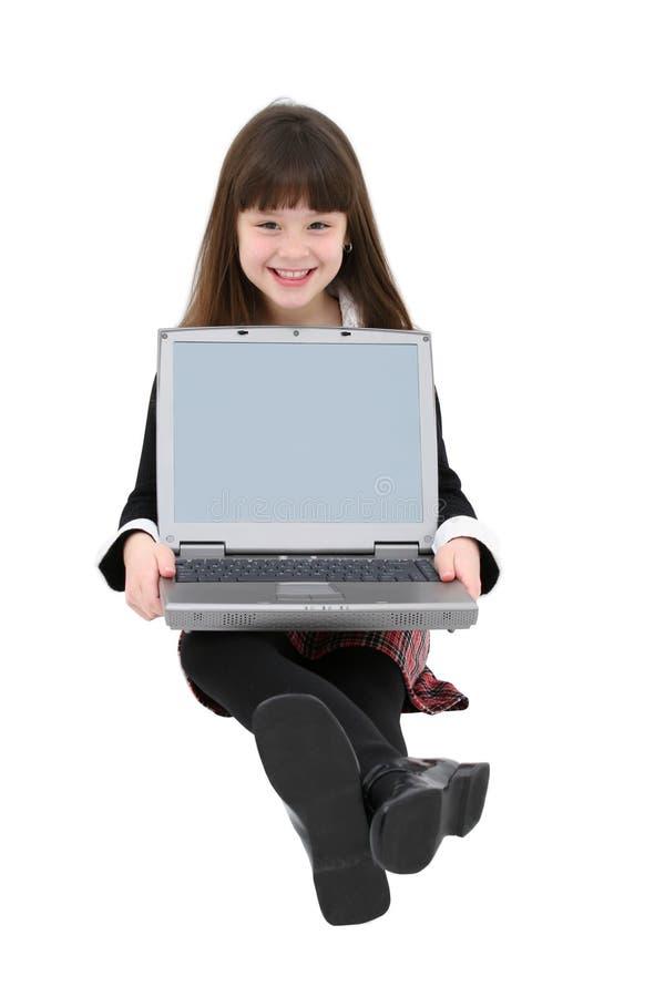 Enfant à l'aide de l'ordinateur portatif image libre de droits