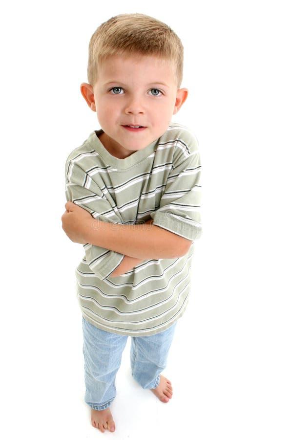 Enfant aux pieds nus de garçon photographie stock