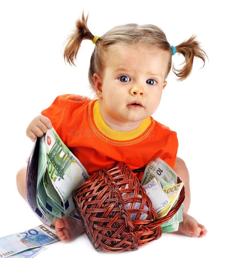 Enfant avec de l'euro argent. photo stock