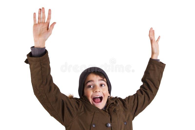 Enfant avec des vêtements d'hiver d'isolement sur le blanc photo stock