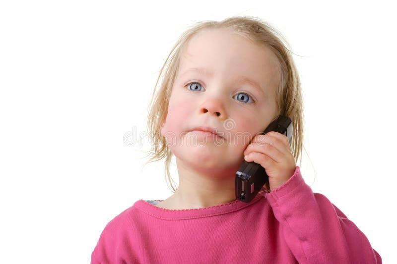 Enfant avec la cellule image libre de droits