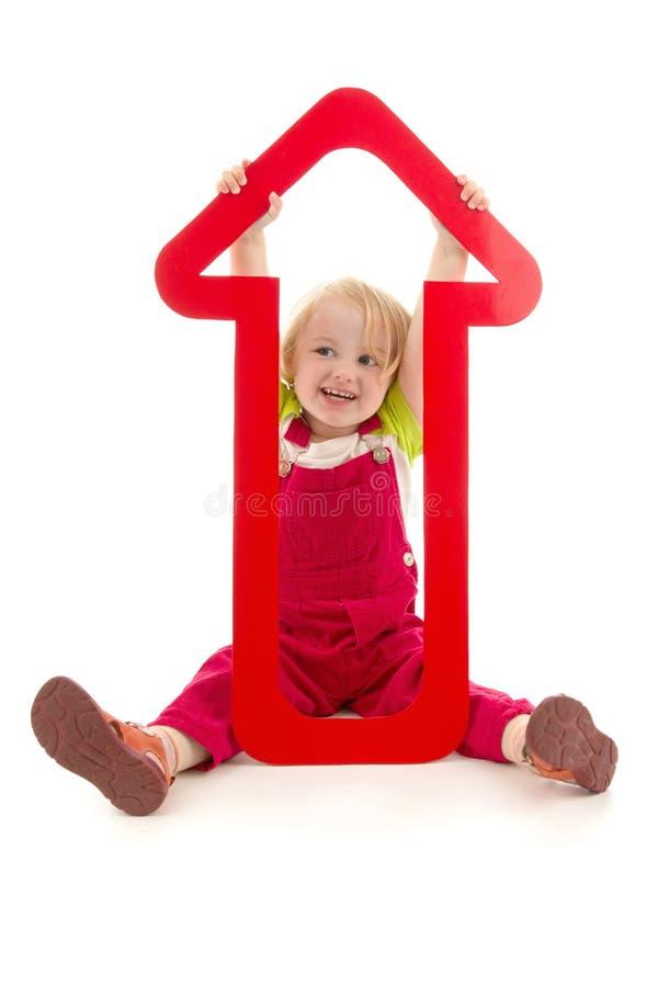 Enfant avec la flèche rouge photos libres de droits