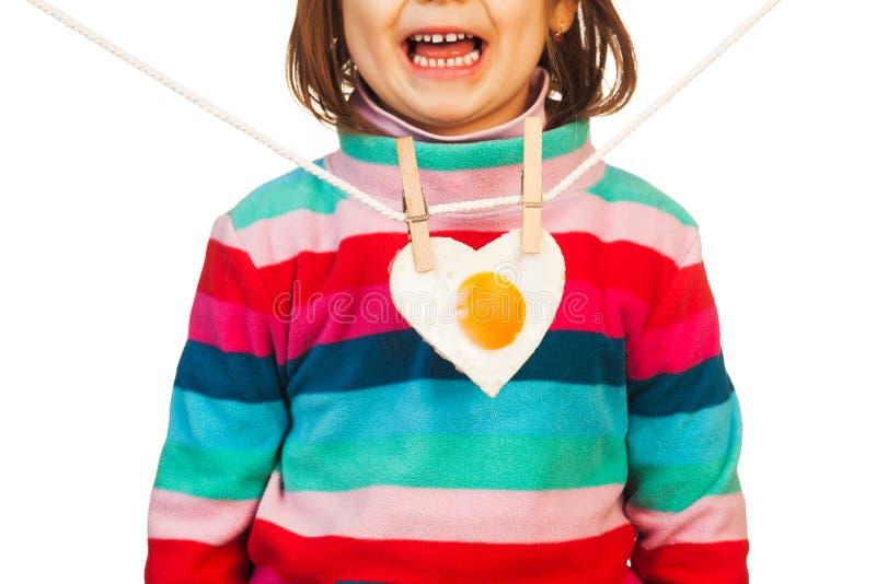Enfant avec la forme nouvelle de coeur image libre de droits