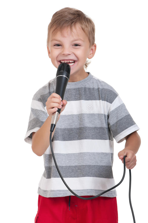 Enfant avec le microphone photo stock