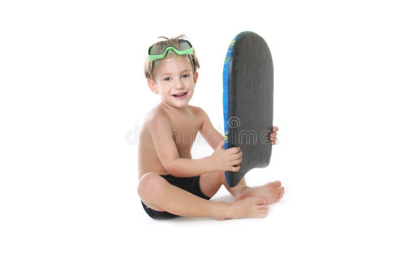 Enfant avec le panneau de natation au-dessus du blanc images stock