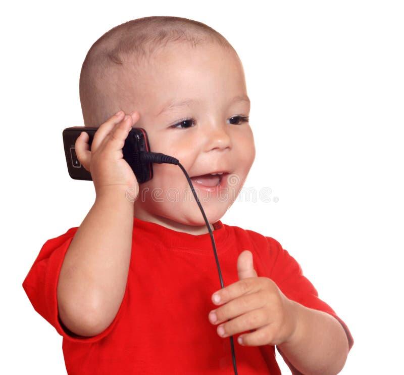 Enfant avec le téléphone portable photos libres de droits