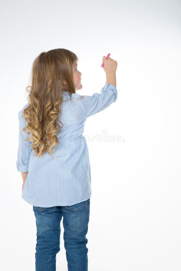 Enfant blond et en bas âge par derrière photographie stock