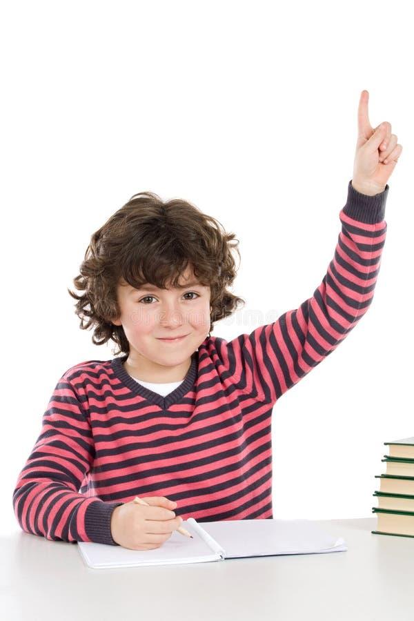 Enfant dans l'école demandant l'étage images libres de droits