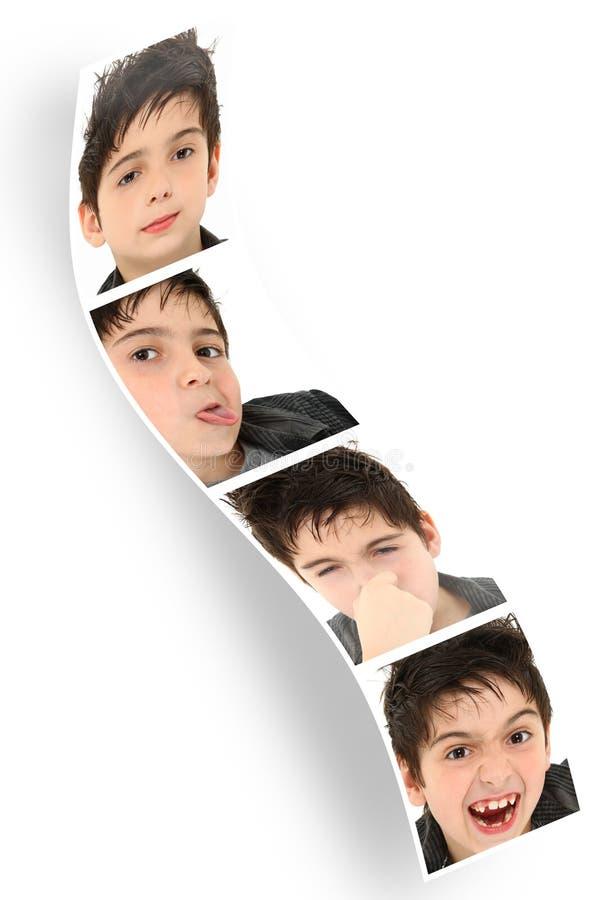Enfant de bande de cabine de photo effectuant des visages photographie stock
