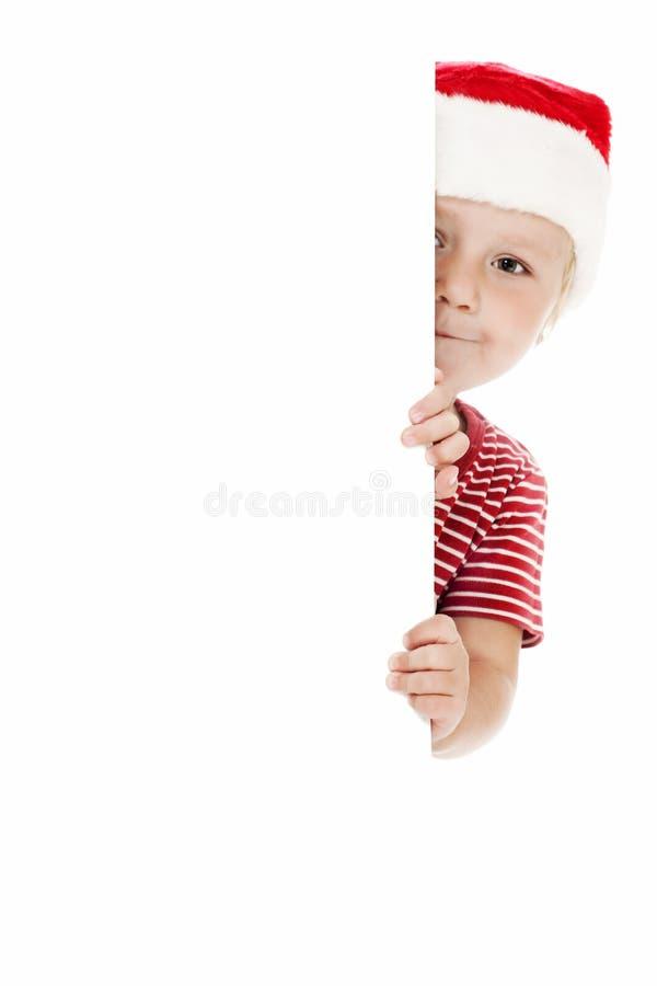 Enfant de sourire avec le chapeau de Noël photos stock