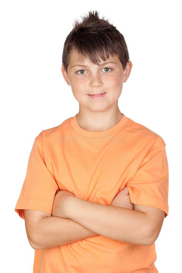 Enfant drôle avec le T-shirt orange images libres de droits