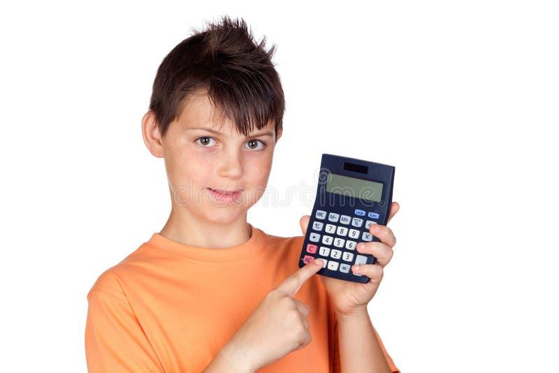Enfant drôle avec une calculatrice photo stock