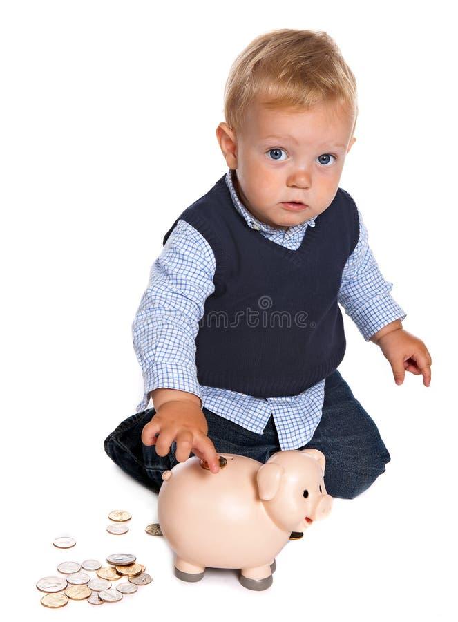 Enfant en bas âge avec la tirelire images stock