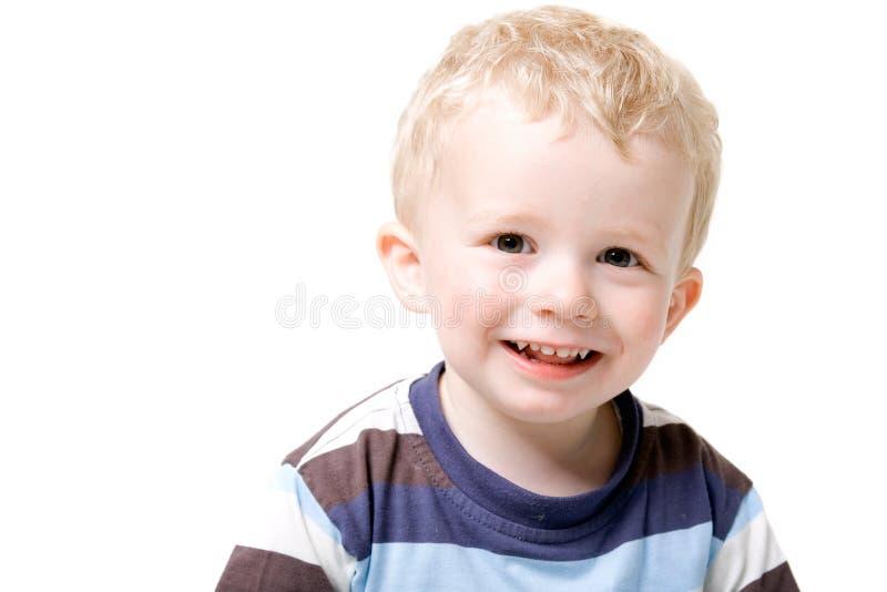 Enfant en bas âge de garçon d'isolement sur le blanc image libre de droits