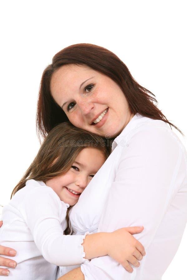 Enfant en bas âge retenu par la mère photographie stock libre de droits