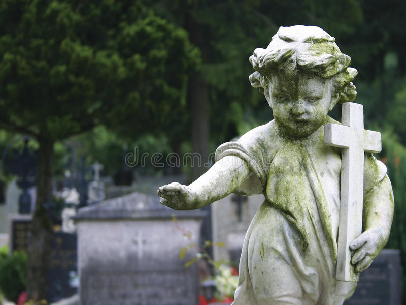 Enfant en pierre de statue image libre de droits