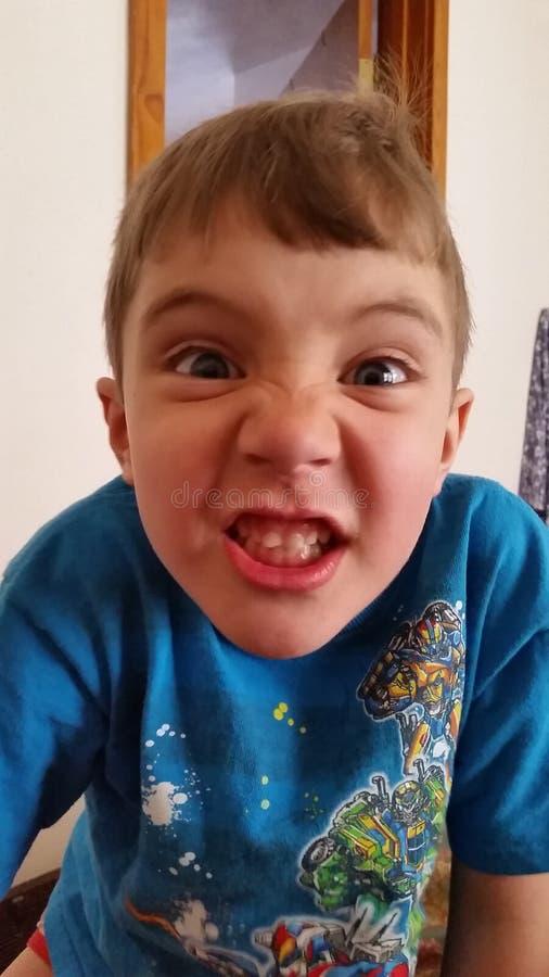 Enfant fâché de visage image stock