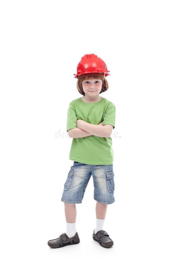 Enfant fier avec le sien casque antichoc de père images stock