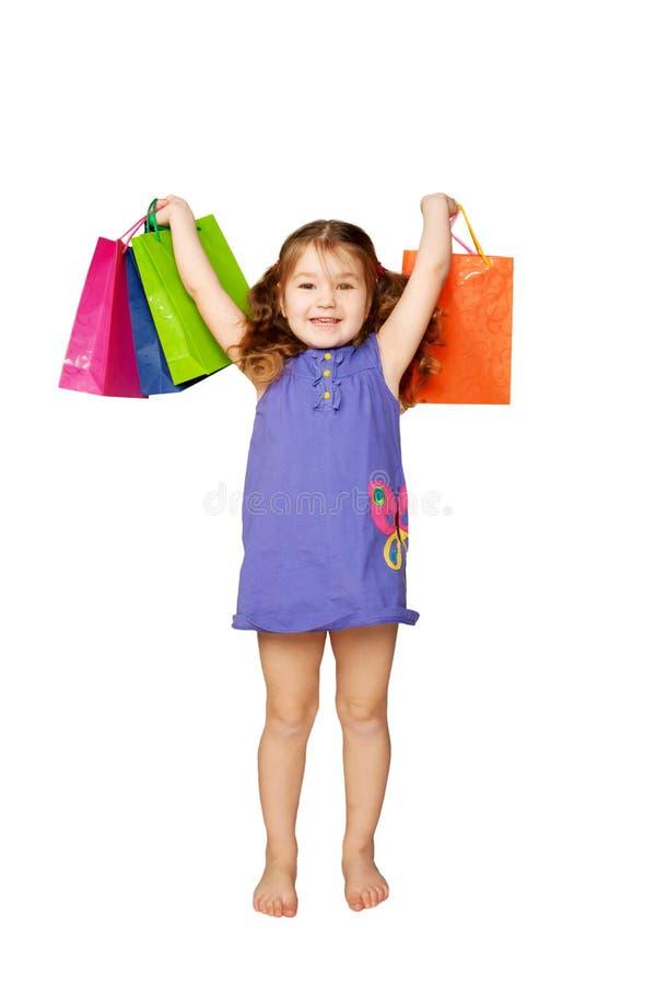 Enfant heureux appréciant des cadeaux et des vacances images libres de droits