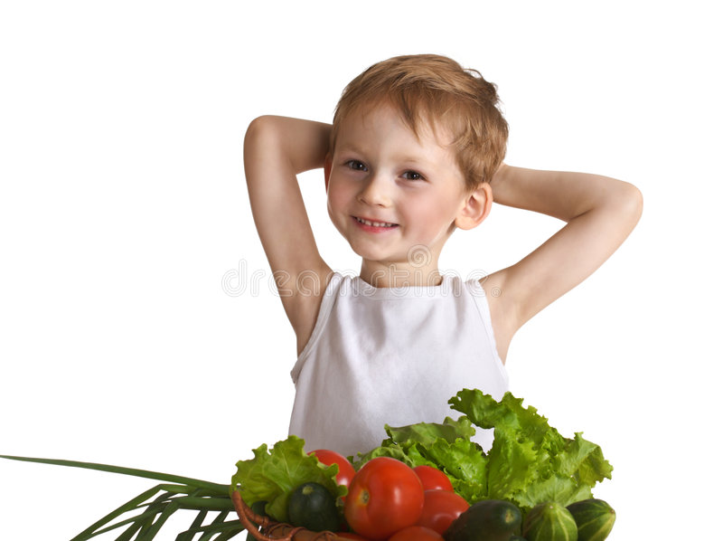 Enfant heureux avec des légumes photos stock