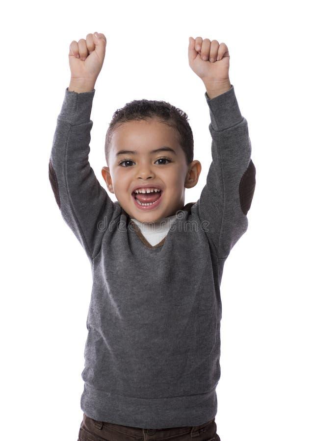 Enfant heureux avec des mains vers le haut photo libre de droits