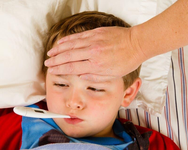 Enfant malade photographie stock libre de droits