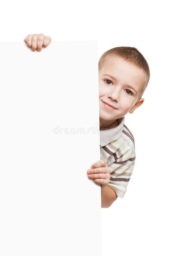 Enfant retenant la plaquette blanc photo libre de droits