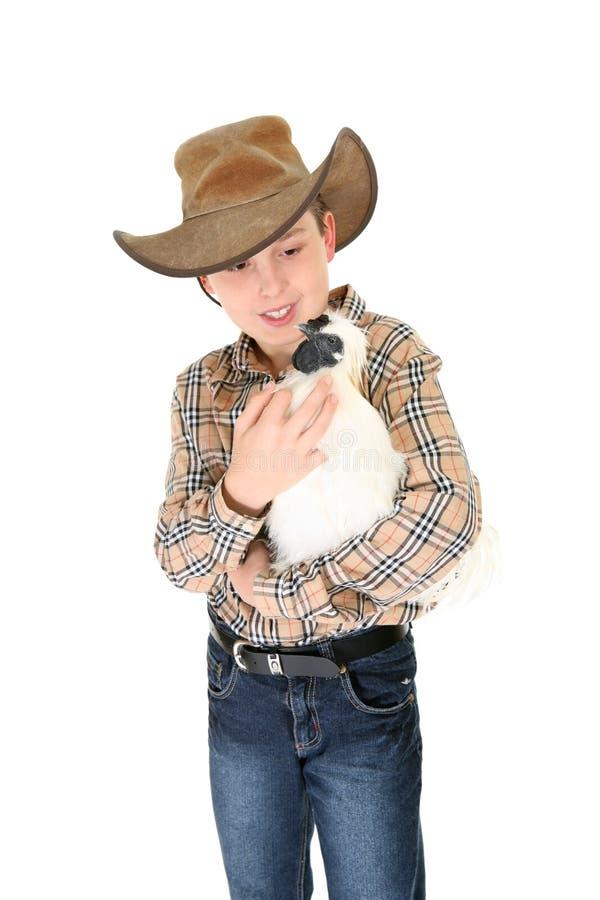 Enfant retenant un coq nain image stock