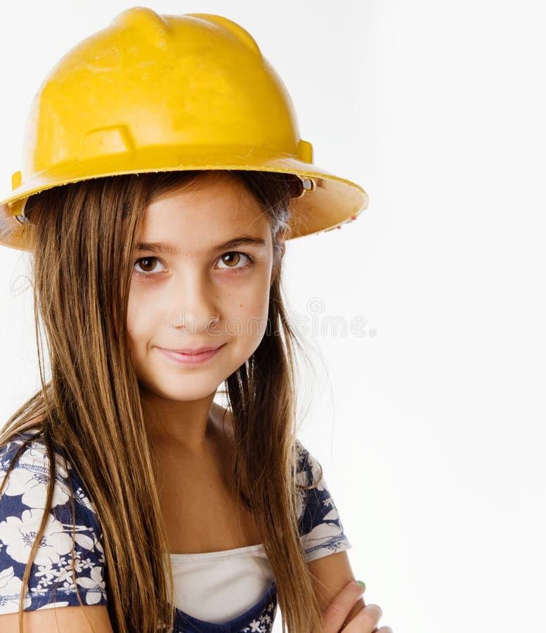 Enfant s'usant le casque jaune de construction photo libre de droits