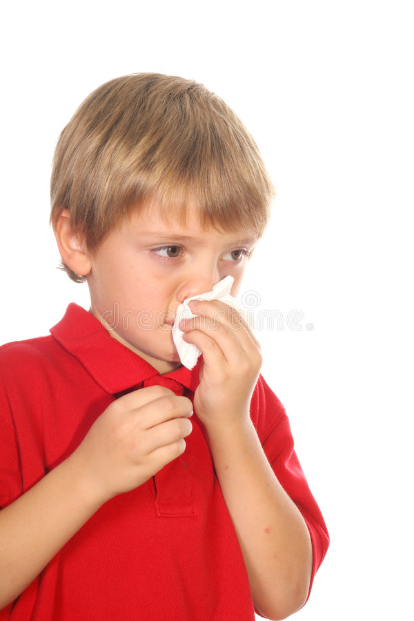 Enfant soufflant son nez photos libres de droits