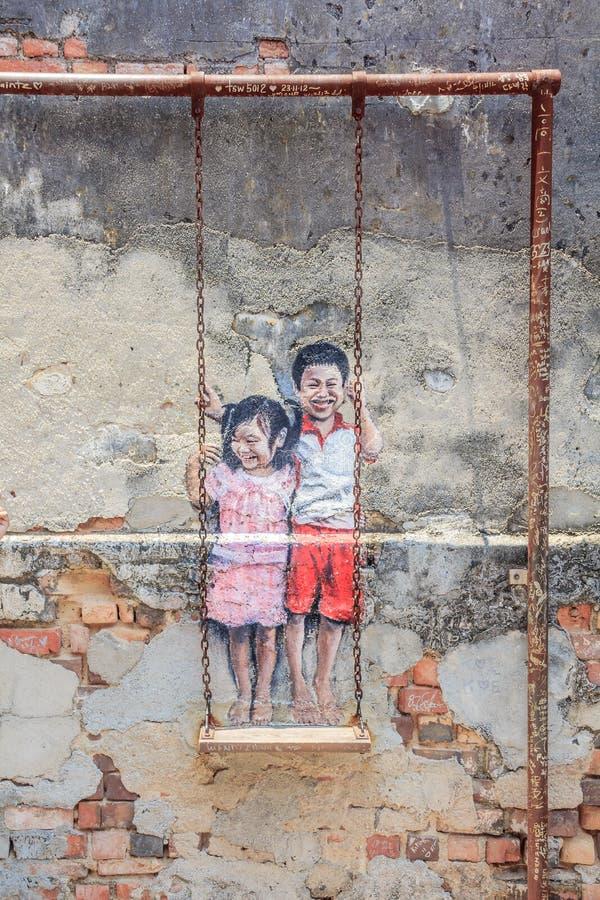 Enfants appelés d'illustration de mur de Penang sur l'oscillation photographie stock libre de droits