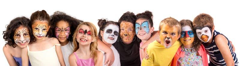 Enfants avec la visage-peinture images libres de droits