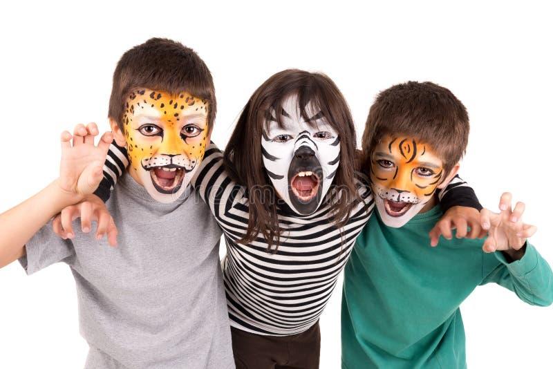 Enfants avec la visage-peinture photos libres de droits