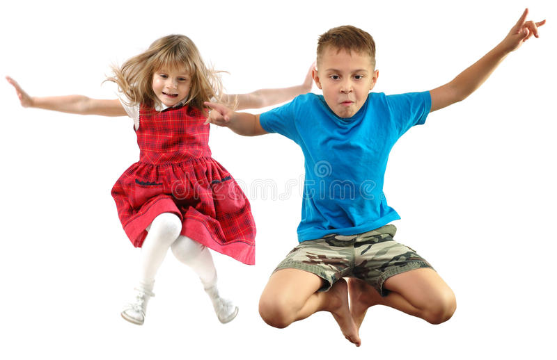 Enfants d'enfants sautant et regardant vers le bas images libres de droits