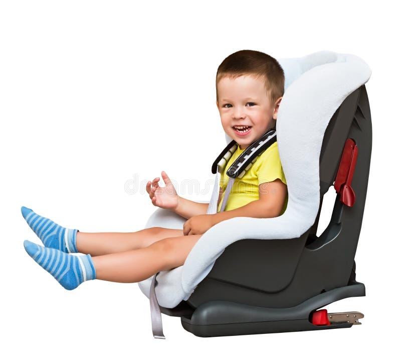 Enfants dans un siège de voiture d'enfant photo stock