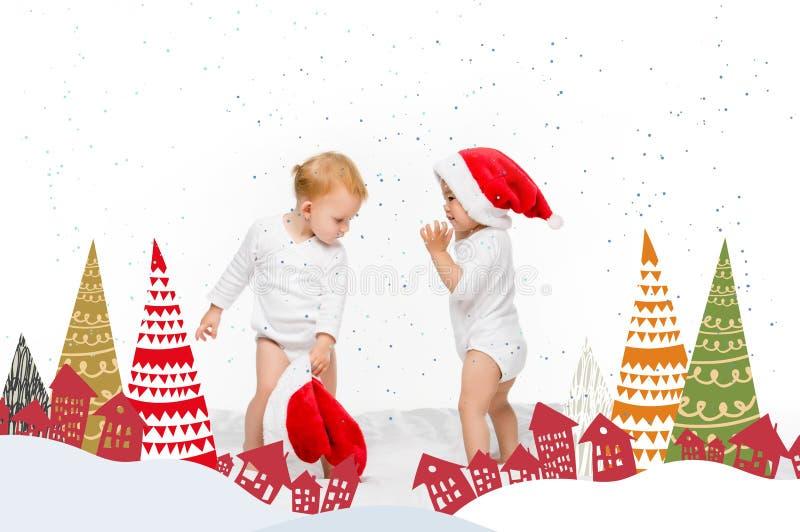 enfants en bas âge avec des chapeaux de Santa image stock