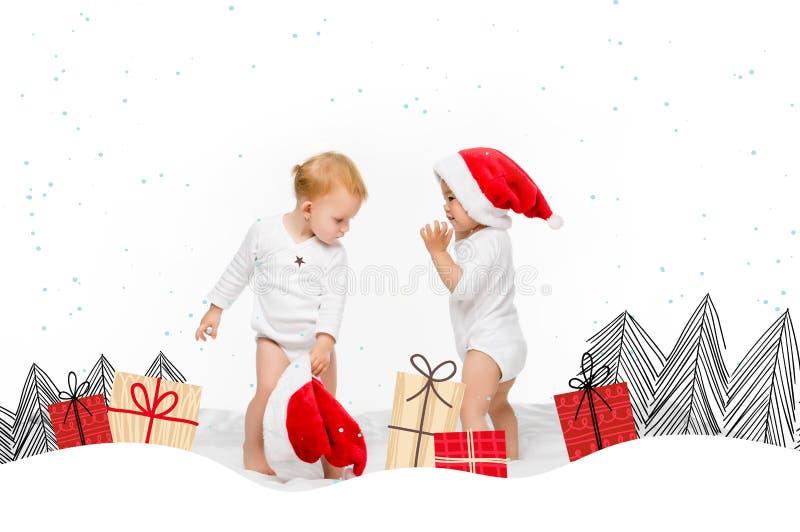 enfants en bas âge avec des chapeaux de Santa images libres de droits