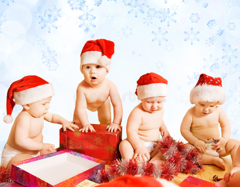 enfants en bas âge de chapeaux de Noël photo stock
