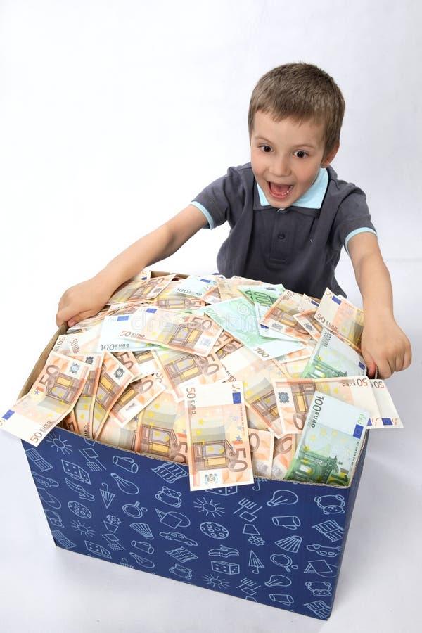 Enfants et cadre avec de l'argent photographie stock