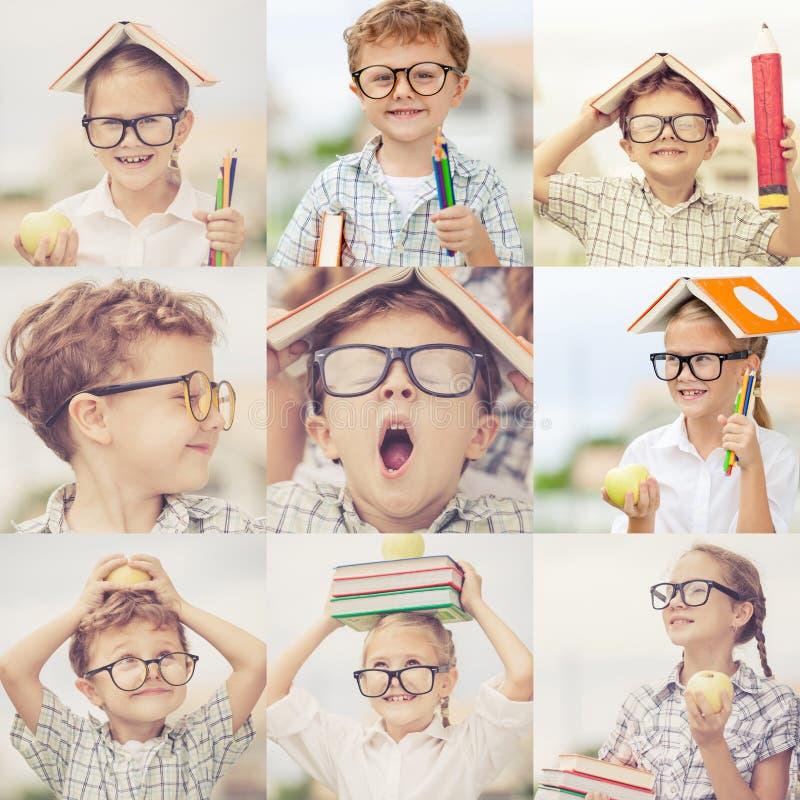 Enfants heureux jouant dehors au temps de jour image stock