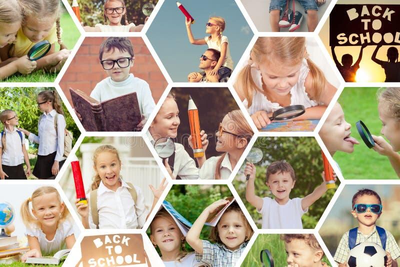Enfants heureux jouant dehors au temps de jour photos libres de droits
