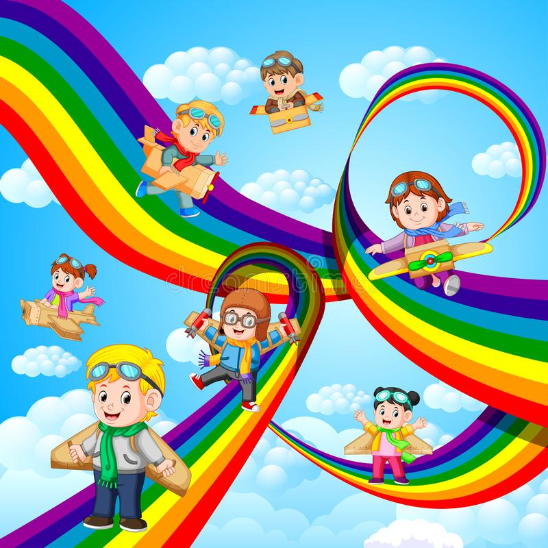 Enfants heureux jouant le vol plat de carton au-dessus de l'arc-en-ciel illustration libre de droits