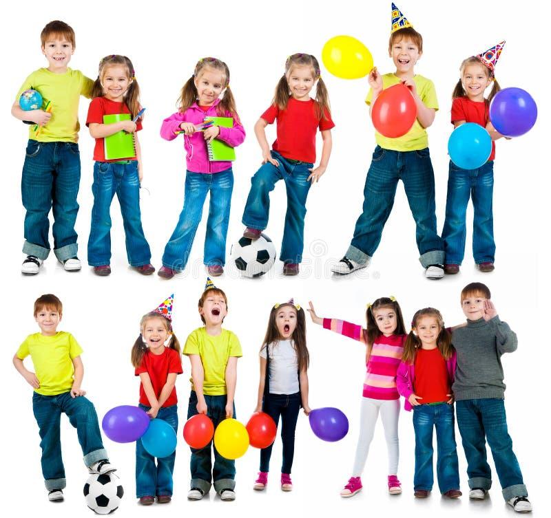 Enfants heureux sur un blanc photos stock